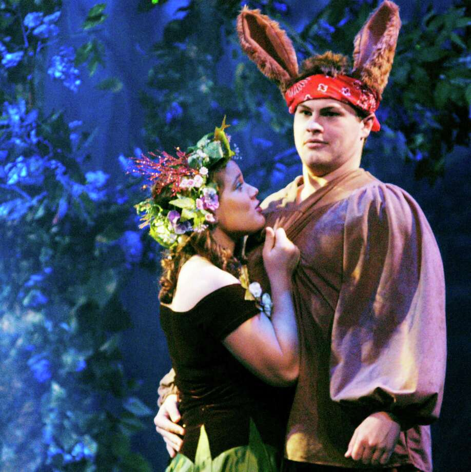 """Nick Bottom, portrayed by Connor Lynch of Pawling, N.Y., does his best to fend off the amorous advances of a spellbound Titania, played by Loren Winters of Sherman, during rehearsal for Canterbury School's presentation of Shakespeare's """"A Midsummer Night's Dream."""" November 2014 Photo: Norm Cummings / The News-Times"""