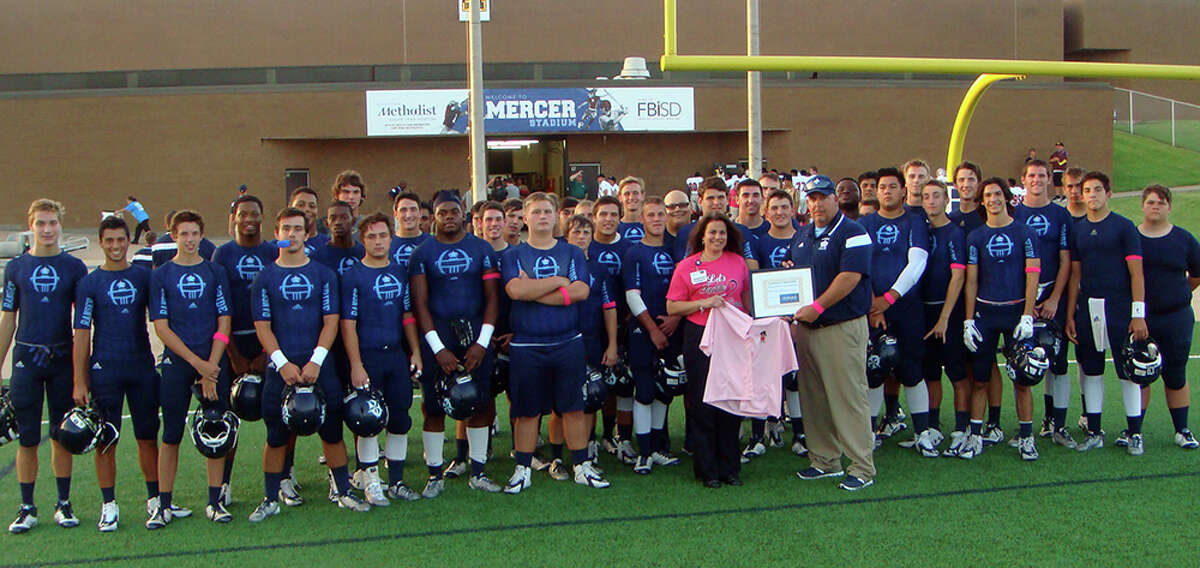 Athletes from the Clements High School donated a number of post-mastectomy pocketed button-up shirts to the Houston Methodist Sugar Land Hospitalés Breast Care Center. With the Clements High School varsity football team are Breast Care Navigator Maria Socci and Coach Keith Knowles.