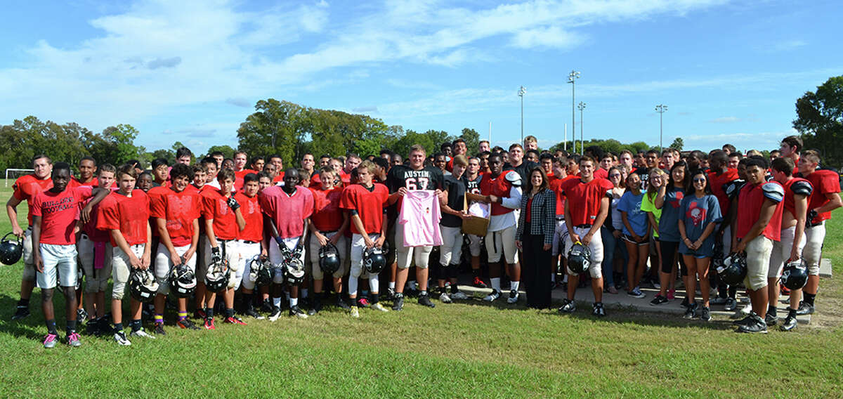 Athletes from the Austin High School donated a number of post-mastectomy pocketed button-up shirts to the Houston Methodist Sugar Land Hospitalés Breast Care Center. With the Stephen F. Austin High School football team is Breast Care Navigator Maria Socci.