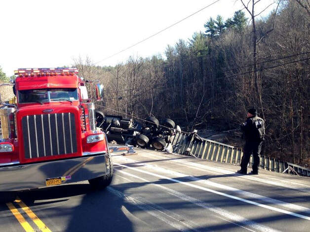 Emergency workers respond to the scene of a tractor trailer rollover on Route 7 in Hoosick Wednesday morning, Nov. 19, 2014. (Paul Buckowski/Times Union)