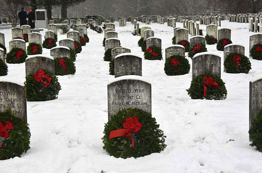 Wreaths decorate the graves of veterans buried in Spring Grove Veterans Cemetery, an annual holiday project organized by Wreaths Across America. Photo: File Photo / Darien News