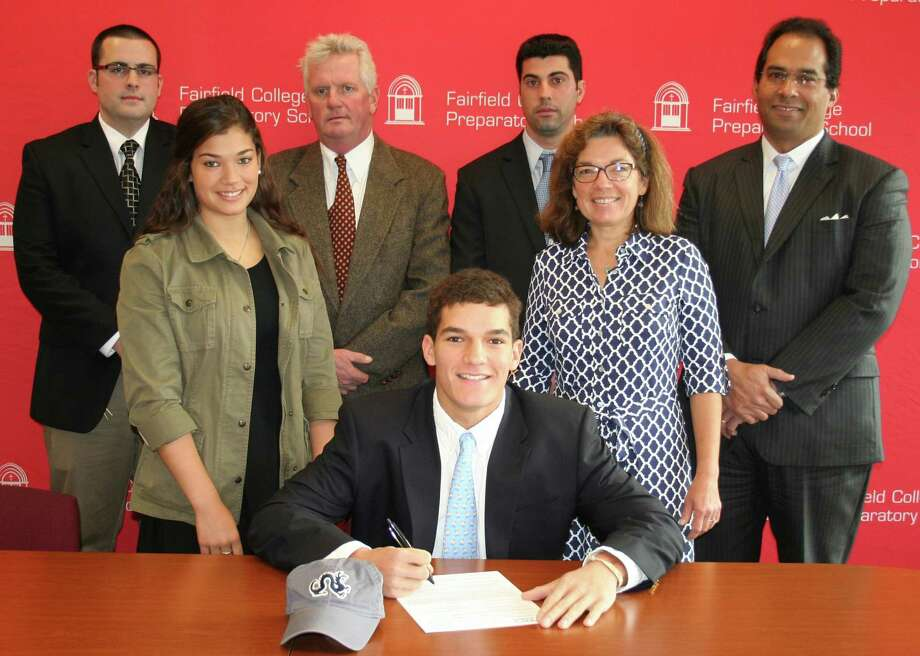 Cam with parents Carole and Brock (at right and back right), and sister Sarah (left). Back row from left: Asst. Athletic Director Jay Turiano, Varsity Lacrosse Coach Chris Smalkais, and Athletic Director Tom Curran. Photo: Contirbuted, Contributed / New Canaan News