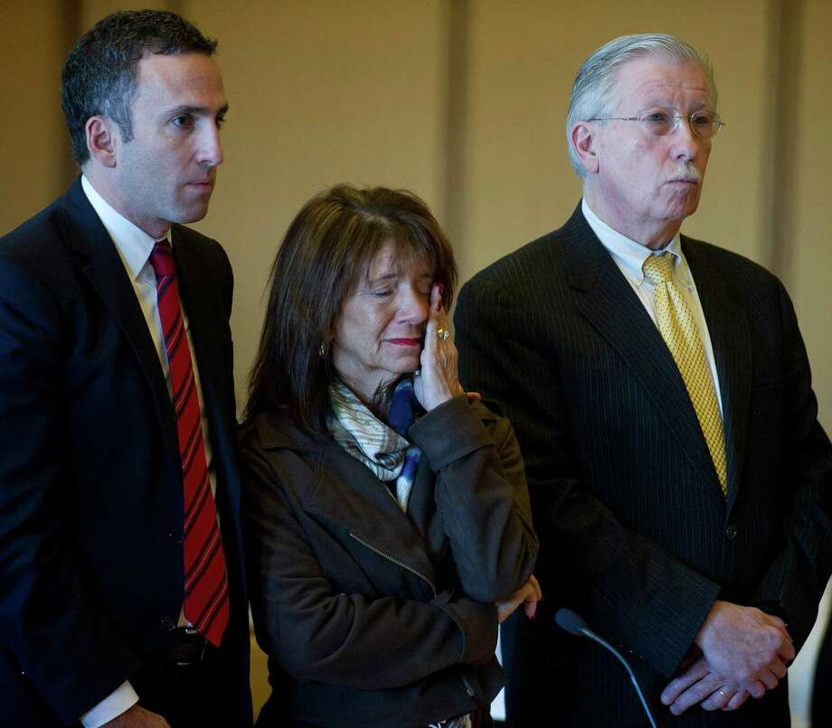 Stamford High School Principal Donna Valentine wipes away a tear as she appears in State Superior Court in Stamford, Conn., on Tuesday, November 19, 2014, where she was granted accelerated rehabilitation. Photo: Lindsay Perry / Stamford Advocate