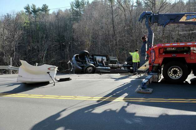Clean up work continues at the scene on Route 7 where a tractor trailer heading east lost control and crashed on Wednesday, Nov. 19, 2014, in Hoosick, N.Y.  (Paul Buckowski / Times Union) Photo: Paul Buckowski / 00029552A