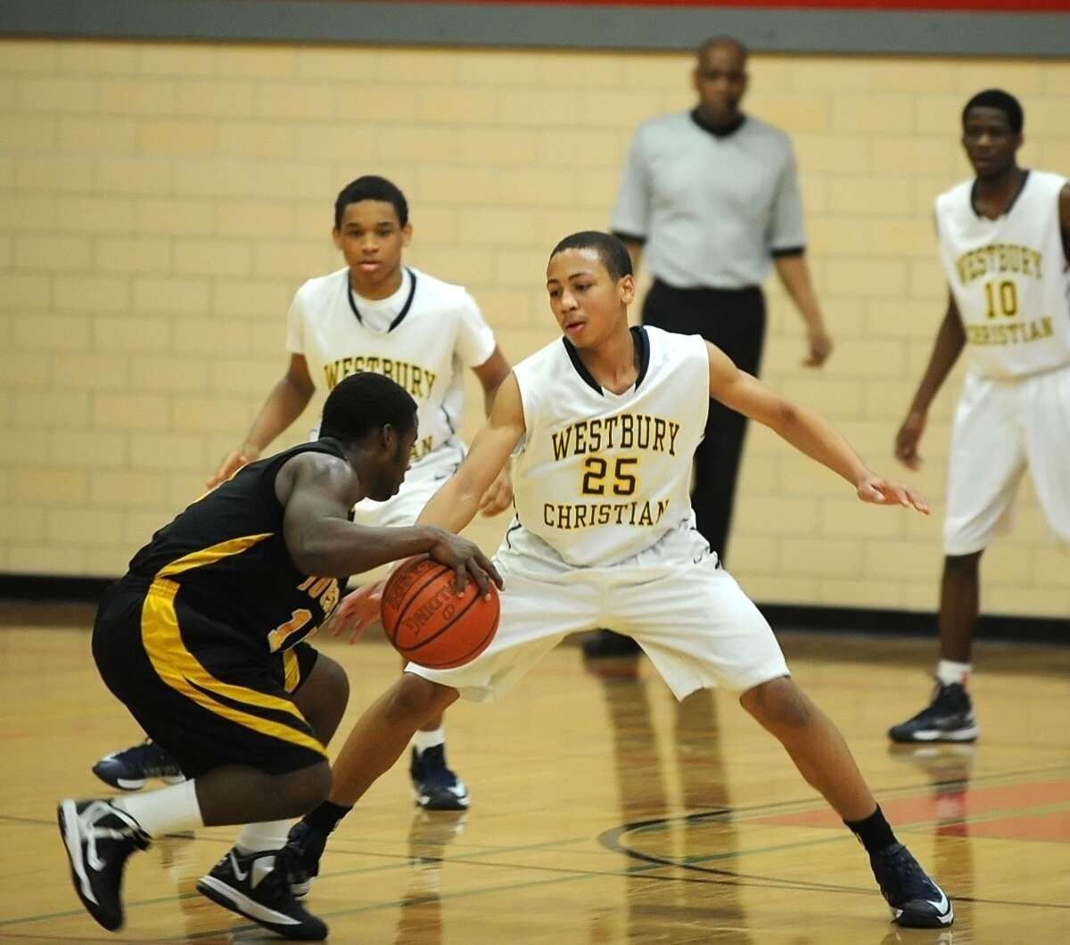 Westbury Christian's Galen Robinson (25) is one of the area's top point guards.