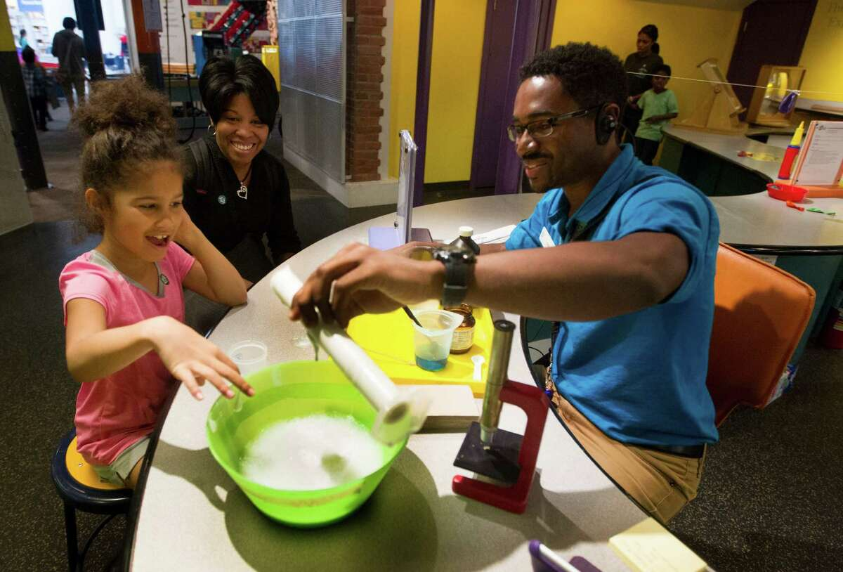 The Houston Children's Museum offers a Sensory Friendly Day, which gives kids with Autism Spectrum Disorders an opportunity to explore the museum in their own way and time. Odis Garrett, right, shows Naomi Marvin, 8, and her mother Miranda how to make a mixture of hydrogen peroxide and detergent called elephant toothpaste while visiting the Children's Museum in Houston.