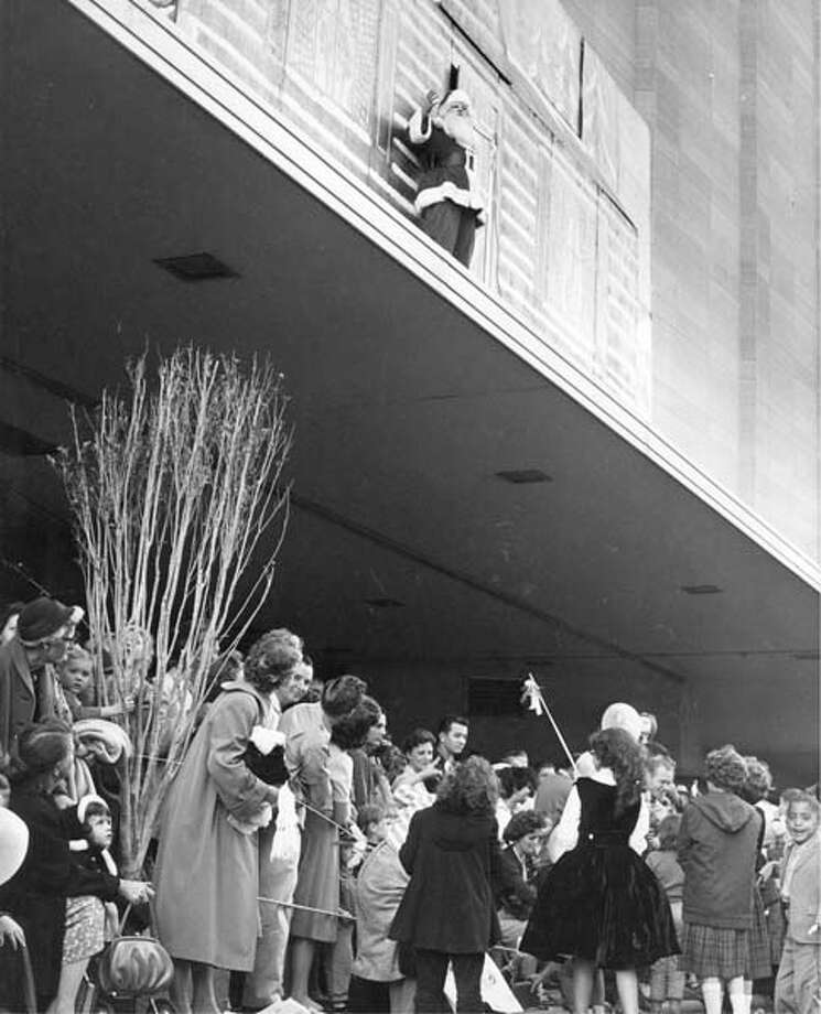 It's the high point of the parade Santa Claus addresses parade goers atop a Foley's canopy following the 1960 Foley's Thanksgiving Day Parade. Chuck Farmer / Houston Post Photo: Chuck Farmer, Chronicle File / Houston Post files
