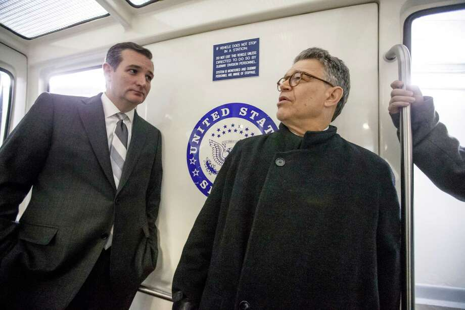 Sen. Ted Cruz, R-Texas (left), shown with Sen. Al Franken, joined Democrats in supporting reforms. Photo: J. Scott Applewhite / Associated Press / AP