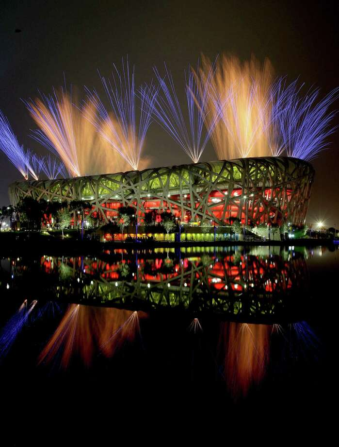 "The sky comes alive with fireworks outside of the ""Birds Nest"" (National Outdoor Stadium), marking the end of the opening ceremonies of the 2008 Beijing Olympics, on July 23, 2008 in Beijing, China. Photo: Michael Macor / The Chronicle / ONLINE_YES"