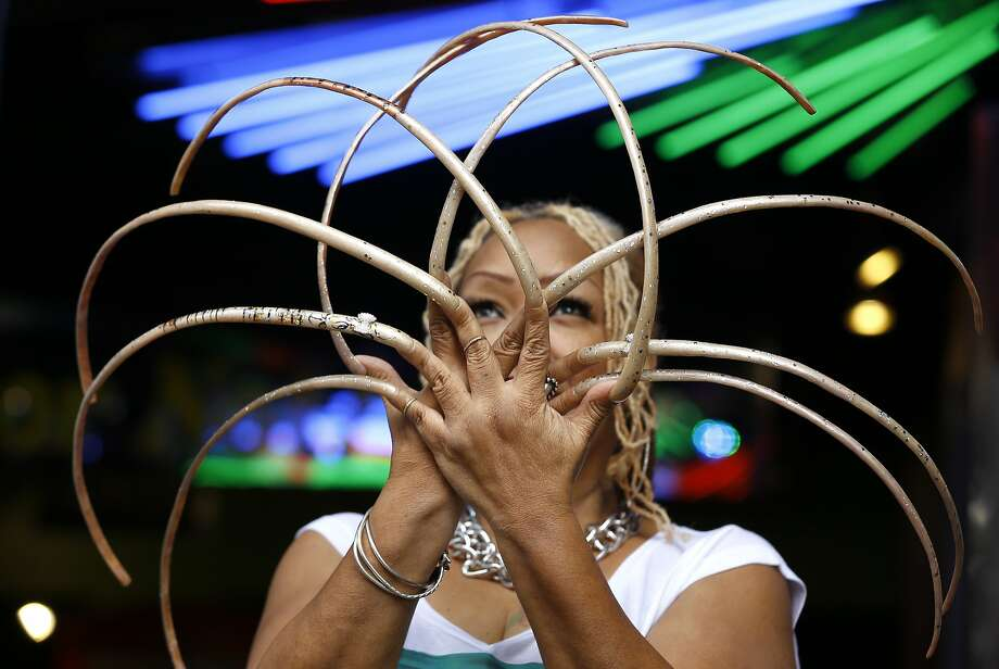NINE INCH NAILS OWES HER 14: Ayanna Williams displays her 23-inch nails at a book launch in London for 'Ripley's Believe it or Not! 2015 Annual, Reality Shock'. Photo: Kirsty Wigglesworth, Associated Press