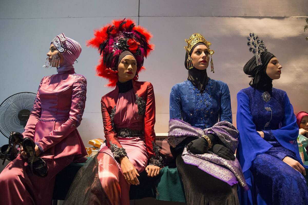 SURE BEATS A BURQA: Models wearing creations from the Calvin Thoo collection wait at the backstage before the Islamic Fashion Festival in Kuala Lumpur, Malaysia.