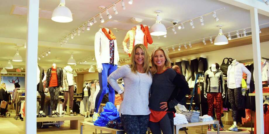 At the new Athleta store on Main Street are store manager Jessica Benno, left, and district manager Lisa Souza. Photo: Todd Tracy / Westport News