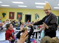 Chris Moretti, 48, is the new principal of Hawley Elementary School in Newtown, Conn. Moretti was a standup comedian before he went into education. Wednesday, Nov. 19, 2014,  he visits a lunchroom filled with First-graders wearing a turkey hat in honor of the Thanksgiving holiday.