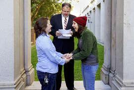 Kayla Bennett (left) and Kristin Anderson exchange wedding vows before Minister Tobin Williamson in Charleston, S.C.