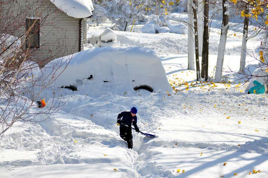 Drew Ahmed makes his way through nearly five feet of snow on November 19, 2014 in the Lakeview neighborhood of Buffalo, New York. The record setting Lake effect snowstorm dumped up to six feet of snow in less than 24 hours closing a one hundred mile section of The New York State Thruway as well as other major roads around Buffalo. Four deaths have already been  attributed to the storm and a second round beginning late Wednesday evening will bring up to three more feet of snow overnight. Photo: John Normile, Getty Images