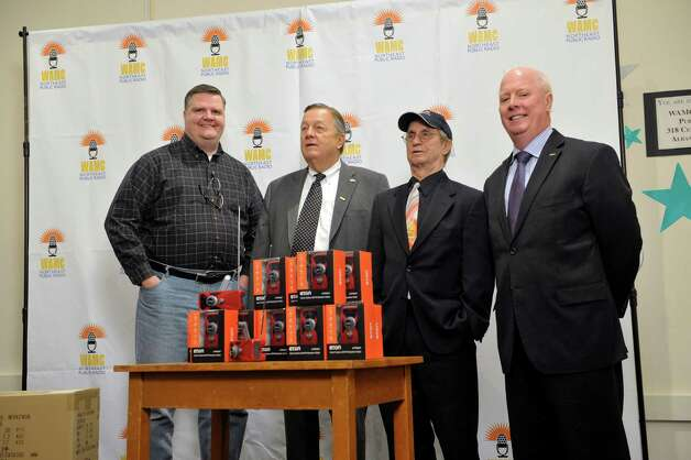 From left, Joe Donahue, WAMC vice president; John Downing, CEO of Soldier On; Alan Chartock, WAMC CEO and president; and Gary Shepard, president and COO of Soldier On, at a press event to highlight the donation of Eton Crank Radios to the Soldier On organization on Wednesday, Nov. 19, 2014, at WAMC in Albany, N.Y.  (Paul Buckowski / Times Union) Photo: Paul Buckowski / 00029542A