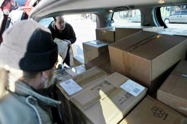 Drivers for the organization Soldier On, Rich Floeter, foreground, and Ralph Thompson, load a van with Eton Crank Radios outside the WAMC studios on Wednesday, Nov. 19, 2014, in Albany, N.Y.  (Paul Buckowski / Times Union) Photo: Paul Buckowski / 00029542A