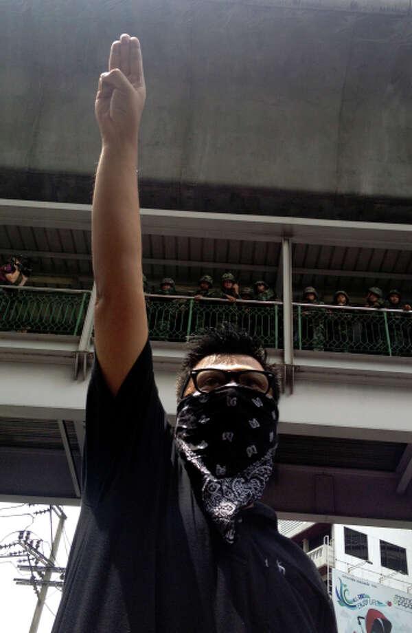A protester gives a three-finger salute at a June rally in Bangkok. Photo: Thanyarat Doksone / Associated Press / AP