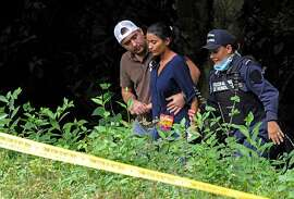 Honduran policemen comfort Kory Alvarado (C), after she identified the bodies of her sisters former Miss Honduras Maria Jose Alvarado and Sofia Trinidad, in the banks of the Aguagua river in the La Arada-Caulotales road in the Santa Barbara department, 200 km northwest of Tegucigalpa. The two women were missing since last November 13 after attending a birthday party at Aguagua thermal resort.   AFP PHOTO/Orlando SIERRA.ORLANDO SIERRA/AFP/Getty Images