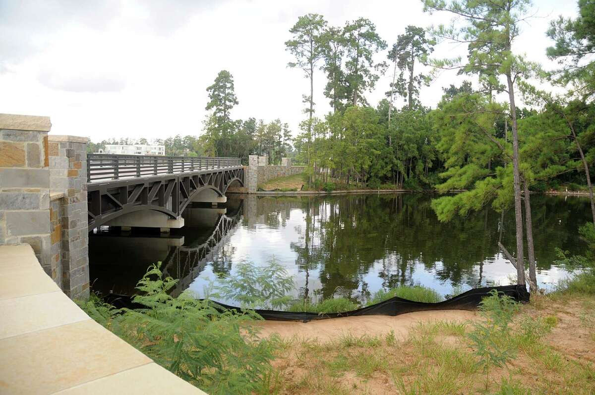 The new bridge that will connect Mitchell Island, on the east side of Lake Woodlands, will open the island to a new exclusive community that will be developed on the island. The bridge is located at Timberloch Place and Majestry Row. Photograph by David Hopper