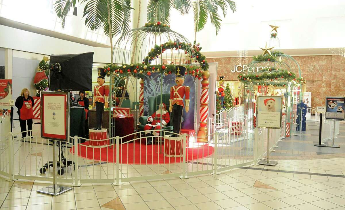 Santa waits for children at Willowbrrok Mall, 2000 Willowbrook Mall in Houston. Photograph by David Hopper
