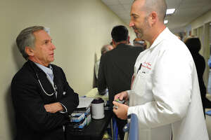 Chief of Infectious Diseases Dr. Zane Saul, left, talks with Emergency Department physician Dr. Donal Conway during an Ebola drill at Bridgeport Hospital in Bridgeport, Conn. on Wednesday, November 19, 2014.