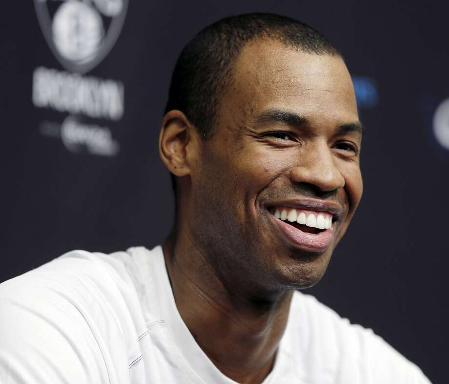 FILE - In this March 3, 2014, file photo,Brooklyn Nets Jason Collins speaks during a news conference before an NBA basketball game against the Chicago Bulls at the Barclays Center in New York. Collins, the NBA's first openly gay player, announced his retirement on Wednesday, Nov. 19, 2014. (AP Photo/Seth Wenig, File) Photo: Seth Wenig, Associated Press
