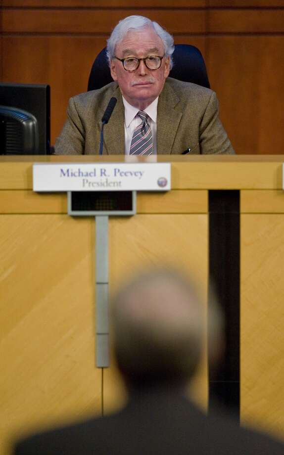 FILE - In this Thursday, Oct. 25, 2012 file photo, Michael Peevey, president of the California Public Utilities Commission, listens to a speaker at Irvine City Hall in Irvine, Calif. Peevey, California's chief utility regulator, under fire over accusations of secret dealings with the state's largest utility, said Thursday, Oct. 9, 2014 that he will not seek reappointment when his term ends at the end of the year. (AP Photo/The Orange County Register, Mark Rightmire, File)   MAGS OUT; LOS ANGELES TIMES OUT Photo: Mark Rightmire, Associated Press