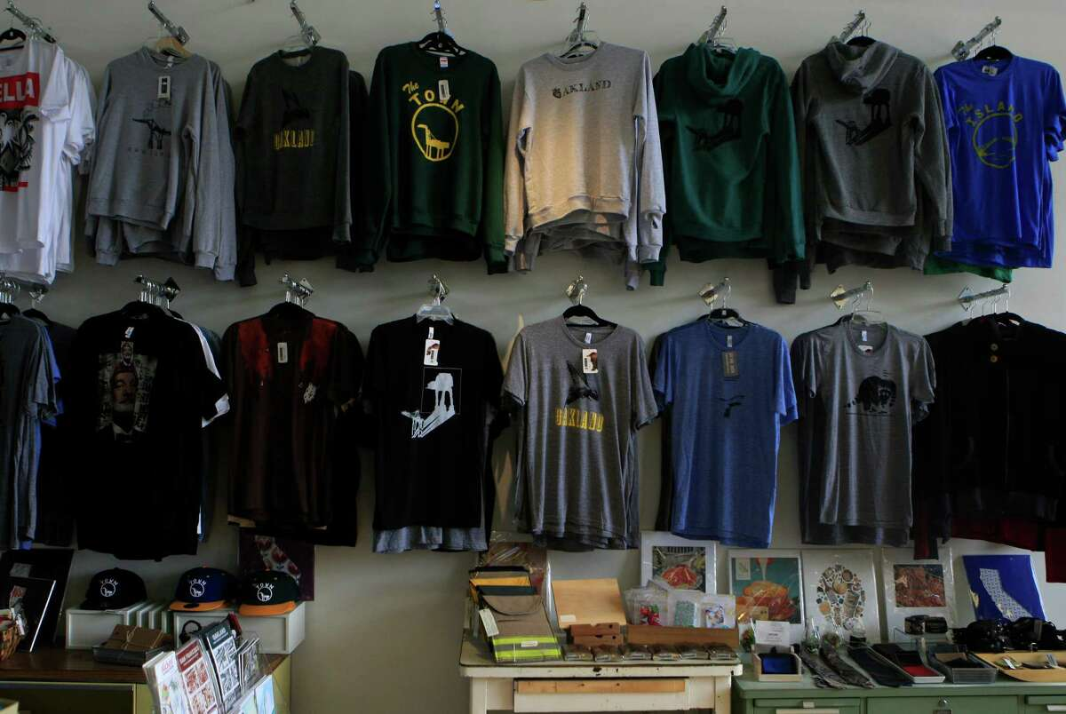 An entire wall is dedicated to Oakland inspired shirts at the LuckyLo store in Oakland, Calif., on Friday November 14, 2014.
