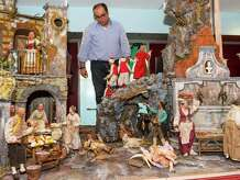 Artist Antonio Cantone inspects his work of installing more than 100 figurines on a 15-foot-wide Neapolitan crèche at the Knights of Columbus Museum in New Haven.