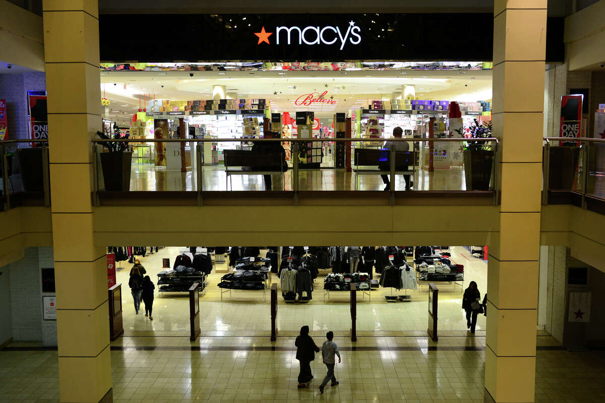 Shoppers go in and out of Macy's at Westfield's Connecticut Post Mall in Milford, Conn., on Wednesday Nov. 19, 2014. Some shoppers have expressed displeasure at the idea of stores and malls being open on Thanksgiving Day, when stores traditionally closed.