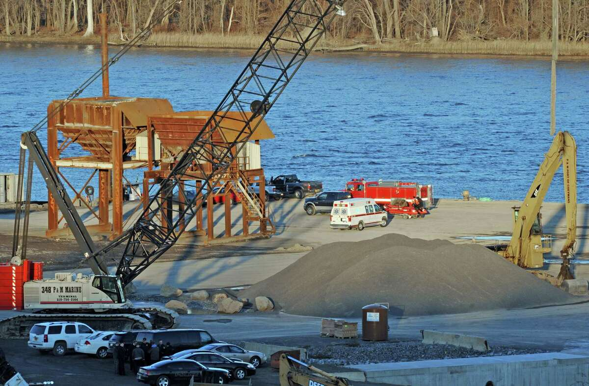 Police and rescue personnel gather to coordinate rocovery efforts for a body found along the Hudson River Wednesday afternoon, Nov. 19, 2014, at the Port of Coeymans in Coeymans, N.Y. (Michael P. Farrell/Times Union)