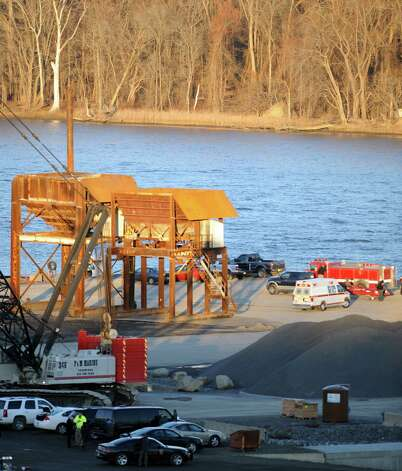 Police and rescue personnel gather to coordinate rocovery efforts for a body found along the Hudson River Wednesday afternoon, Nov. 19, 2014, at the Port of Coeymans in Coeymans, N.Y. (Michael P. Farrell/Times Union) Photo: Michael P. Farrell