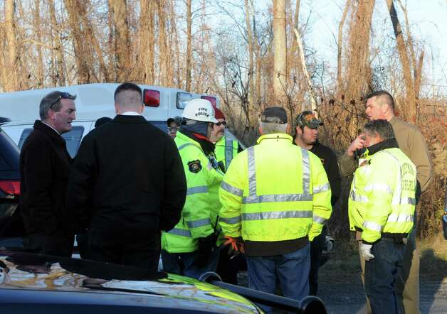 Police and rescue personnel gather at a railroad access road to coordinate recovery efforts for a body found along the Hudson River Wednesday afternoon, Nov. 19, 2014, in Coeymans, N.Y. (Michael P. Farrell/Times Union) Photo: Michael P. Farrell
