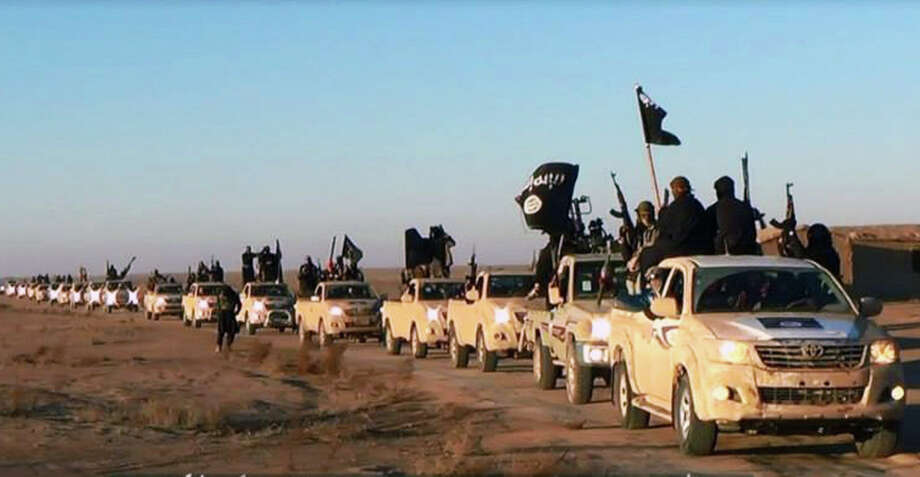 This image posted on a militant website shows a convoy of vehicles and fighters from ISIS.(AP Photo/militant website.) Photo: Uncredited, HOPD / Militant Website