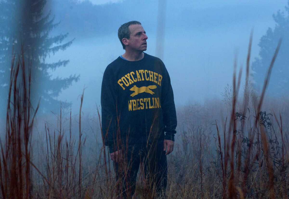 Steve Carell portrays millionaire John du Pont, who takes an Olympic wrestler under his wing in