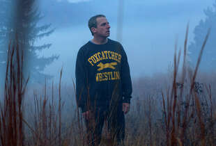 "Steve Carell portrays millionaire John du Pont, who takes an Olympic wrestler under his wing in ""Foxcatcher."""