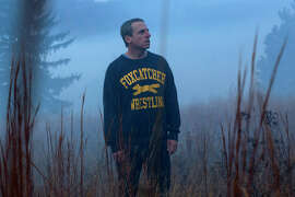 """Steve Carell portrays millionaire John du Pont, who takes an Olympic wrestler under his wing in """"Foxcatcher."""""""