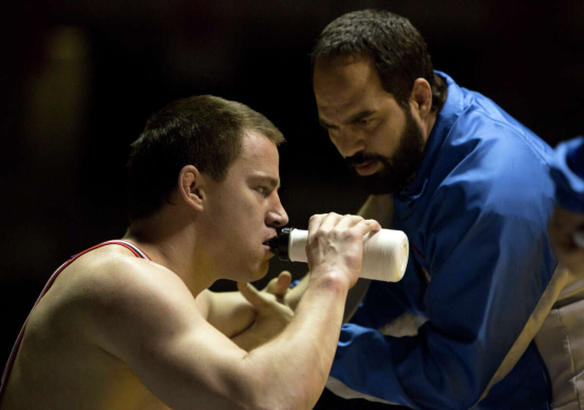 Channing Tatum (left) and Mark Ruffalo play Olympic wrestlers and brothers Mark and Dave Schultz.