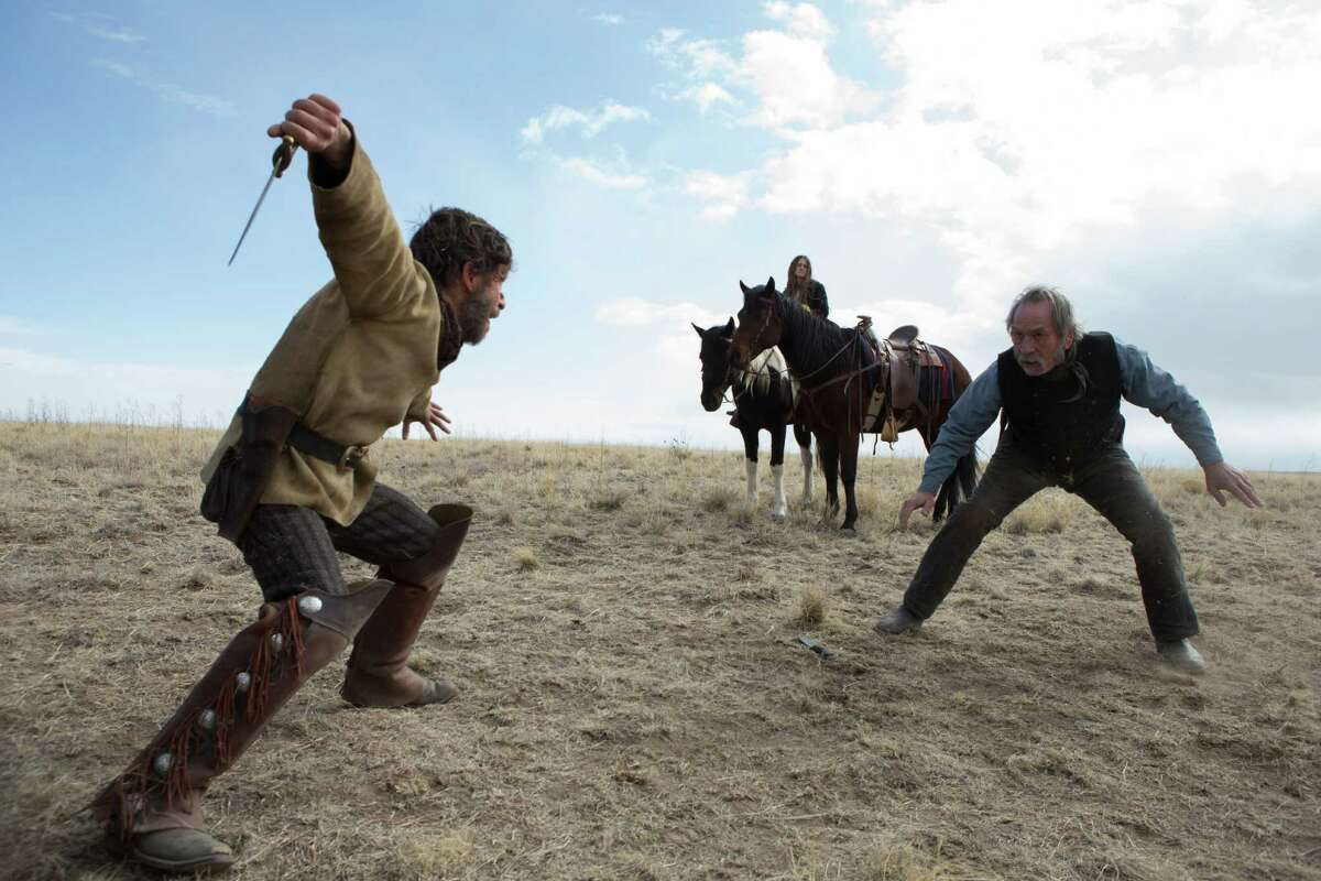 """Tim Blake Nelson (left) and Tommy Lee Jones in """"The Homesman."""""""