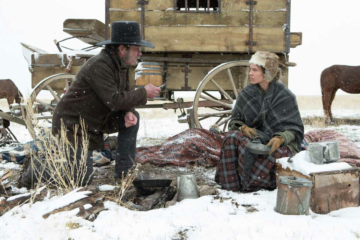 """Tommy Lee Jones (left) and Hilary Swank in """"The Homesman."""""""