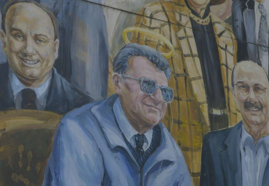"""""""Happy Valley"""" shows a mural including an image of Joe Paterno with a halo, which was later removed. Photo: Music Box Films / Music Box Films / ONLINE_YES"""