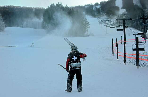 Tom Borman, ski patrol for Windham Mt., looks back at the mountain after making a run down as staff get ready for the ski season at Windham Mountain on Wednesday, Nov. 19, 2014 in Windham, N.Y. The resort opens Friday. (Lori Van Buren / Times Union) Photo: Lori Van Buren
