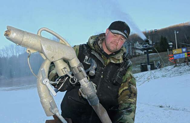 Snow making supervisor Josh Dowdall sets up a snow gun on as staff get ready for the ski season at Windham Mountain on Wednesday, Nov. 19, 2014 in Windham, N.Y. The resort opens Friday. (Lori Van Buren / Times Union) Photo: Lori Van Buren