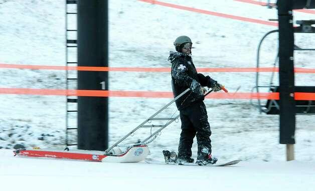 Howard DeVennish, ski patrol for Windham Mt., makes a run down as staff get ready for the ski season at Windham Mountain on Wednesday, Nov. 19, 2014 in Windham, N.Y.  (Lori Van Buren / Times Union) Photo: Lori Van Buren