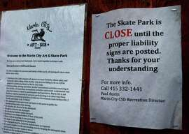 Notices on the entrance to the skatepark define the problem Wednesday November 19, 2014. A new skatepark just completed in Marin City/Sausalito has still not opened because the city hasn't figured out who is responsible if someone gets hurt.