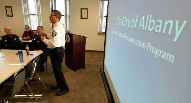 Deputy Chief Brendan Cox leads the discussion at a special Traffic Safety Stakeholder Committee meeting Wednesday afternoon, Nov. 19, 2014, in Albany, N.Y. The meeting was held  to provide the committee, ACPAC members, and Common Council members a chance to provide feedback to the selection process for the intersections that red light cameras will be installed. (Skip Dickstein/Times Union) Photo: SKIP DICKSTEIN / 00029555A