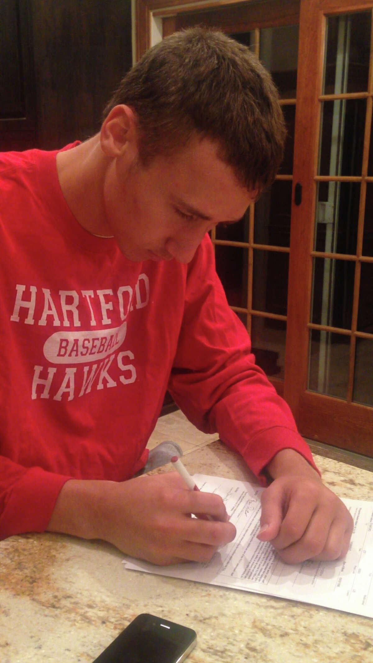Stamford High pitcher Billy DeVito signs a National Letter of Intent to play baseball at the University of Hartford.