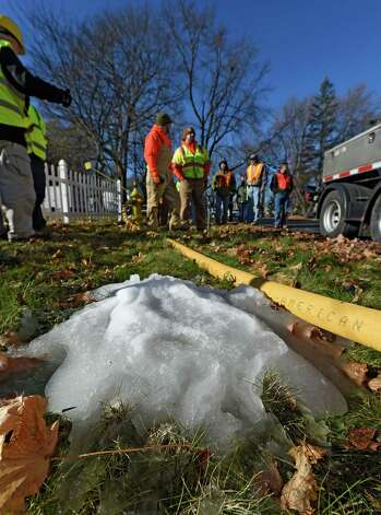 Workers from the Utility Service Group of Atlanta demonstrate their proprietary ice pigging process Wednesday morning Nov. 19, 2014, in Bethlehem, N.Y. The use of ice slurry injected into the water mains, called ice pigging, acts as an efficient way to clean the supply pipes. The Town of Bethlehem is the first in the State to use this method. (Skip Dickstein/Times Union) Photo: SKIP DICKSTEIN / 00029522A