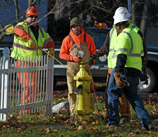 Workers from the Utility Service Group of Atlanta demonstrate their proprietary ice pigging process Wednesday morning Nov. 19, 2014 in Bethlehem, N.Y. The use of ice slurry injected into the water mains, called ice pigging, acts as an efficient way to clean the supply pipes. The Town of Bethlehem is the first in the State to use this method. (Skip Dickstein/Times Union) Photo: SKIP DICKSTEIN / 00029522A